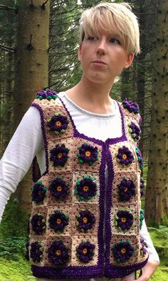 An original design, inspired by deep purple clematis blooms ... Exquisite, one-off crochet squares waistcoat with dark purple 3D flowers in a sparkle fleck yarn surrounded by leaves in various shades of green. Concealed button fastening Loose fit - ideal for UK 8/10/12 (US
