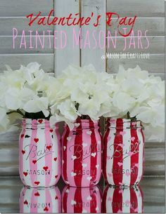 This is pretty straightforward. You will need the following: Mason jars pink/red/white chalk paint washi tape 80 grit sandpaper brush First, paint the jars all white. Stripe the washi tape down the jar all around and paint the pink stripes. Then distress the paint with your sandpaper. After you remove the tape, hand paint the …