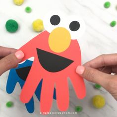 Handprint Sesame Street Craft For Kids This handprint Elmo and Cookie Monster craft for kids is a fun and easy DIY for Sesame Street fans! It's perfect for toddlers, for preschool and for kindergarten children. Make at home, in the classroom or for a Elmo Fun Crafts For Kids, Easy Diy Crafts, Baby Crafts, Preschool Crafts, Diy For Kids, Activities For Kids, Craft Kids, Kindergarten Crafts, Decor Crafts