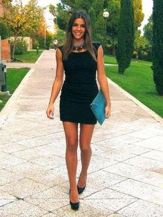 Amazing Collections, black dress and black high heels with a blue bag and a statement necklace