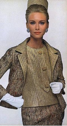 1963 Model in gold-shot suit of silk, wool and Chromeflex and pill-box hat all by Christian Dior-New York, photo by Bert Stern, Vogue