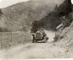 Motorists in Stoddard-Dayton automobile traveling on mountain road at Delaware Water Gap, 1908 Glidden Tour