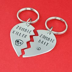 "A perfect gift for you and your BFF!! These broken heart key chains, inspired by The Walking Dead, are stamped with ""zombie killer"" and ""zombie bait"". The Details •Handcrafted using 18 gauge aluminum"