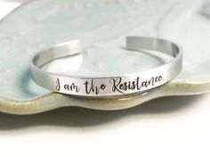I am the resistance ~ Nevertheless she persisted ~ Feminism ~ Feminist ~ Pantsuit Nation ~ Solidarity ~ Unity ~ Political ~ Cuff Bracelet by HarperLeeJewelry on Etsy https://www.etsy.com/listing/502512458/i-am-the-resistance-nevertheless-she