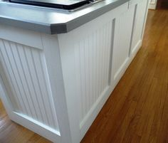 Bead board & wide trim ... would love to do this on back/side of peninsula, but we won't be painting the cabinets.