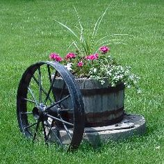 Love it with the old wheel.  Great way to diner that old well cap I yard!!