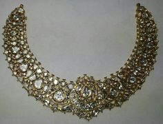 Mugal Kundan meena jewellery set with diamonds.