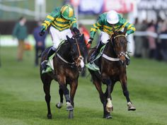 One two for J P McManus as Jezki (left) beats My Tent Or Yours  to win the 2014 Champion Hurdle at Cheltenham.