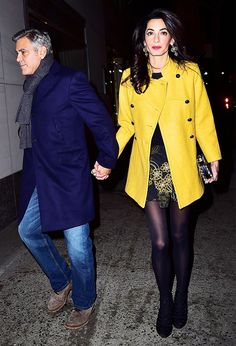 Amal Clooney opts for a bold yellow coat while out on a date with George Clooney