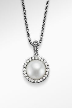 The best of earth and sea meet in this stunning diamond and pearl pendant.