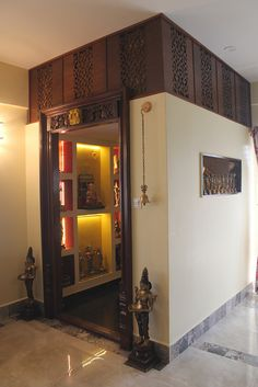 A curation of traditional and modern pooja room / mandir designs for small spaces and apartments. Includes separate pooja rooms and wall mounted shelves.Get Love back Speller 9887506156 Golden life enjoy Temple Room, Home Temple, Temple Design For Home, Home Design, Interior Design, Interior Ideas, Design Ideas, Mandir Design, Pooja Room Door Design