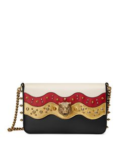 """Gucci wave-motif leather shoulder bag with studs and feline head. Silvertone and golden hardware. Chain shoulder strap, 10"""" drop. Flap top with magnetic closure. Leather mouth detail on back. Interior"""