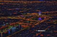 Night view of Paris - This colorful night cityscape shoot by handheld from Tour Eiffel / by Akın Can Şenol is licensed under a Creative Commons Attribution-NonCommercial 4.0 International License.