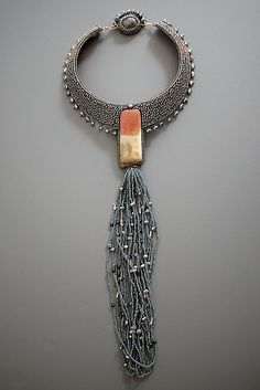 Beadwoven neckpiece by Edda Blume. Whoo - how to make much of a simple but striking rectangular cab.