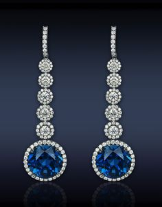 Jacob &Co.  Sapphire Drop Earrings, 44.55cts Blue Sapphires (2 Stones), 3.47cts Round Cut Diamonds (10 Stones), Highlighted with 3.81cts Pave Set White Diamonds (192 Stones). METAL - Type: Black Plated Gold; Weight: 27.7 Grams; Quality: 18K; Size: L - 7.61 cm; W - 2.08 cm