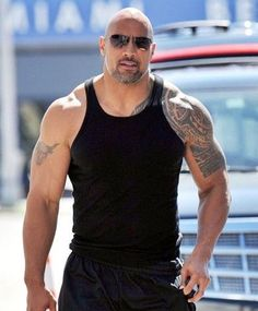 Dwayne Johnson the Rock in a Tank Top showing off his Muscles