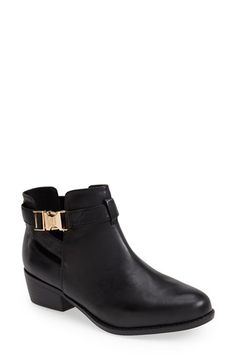 6.5 Black  Topshop 'Bounty' Cutout Boot (Women) at Nordstrom.com. Side cutouts add interesting dimension to a sturdy leather boot secured with a fetching goldtone buckle.
