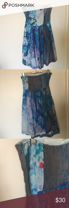 Beautiful Watercolor Strapless Dress Size Medium Stunning Watercolor Strapless Dress. Size Medium. Excellent Used Condition. Brand: Aoyama Itchome. I bought this at a boutique in NYC. It's very well constructed with a side zipper & pockets! It looks great with a belt as well as free flowing. It has a stretchable panel on the back that will expand/contract based on your bust. There is also an underwire in the bodice opposite the zipper. Shell: 30% silk, 70% cotton Lining: 100% Polyester. Dry…