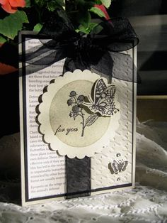 recipe:products from Stampin' Up, Nature Walk stamp set, Clearly For You stamp set, First Edition paper,sahara sand ink and card stock, basic black ink and card stock, black organdy ribbon, houndstooth embossing folder, rhinestones, scallop circle punch