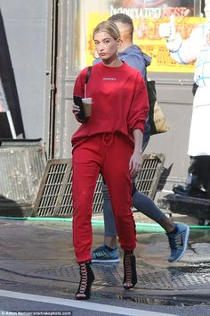 Red alert! Hailey Baldwin strolled through Soho in scarlet on Friday... as the Fyre Festival she promoted crashed and burned in the Bahamas