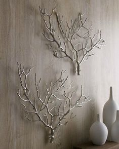 Tree branch wall art.  Spray with silver or white spray paint.