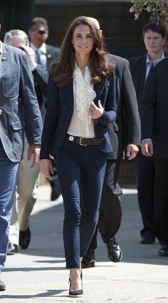 For a more casual outing, Kate Middleton paired a white blouse with J Brand skinny jeans and a blazer.