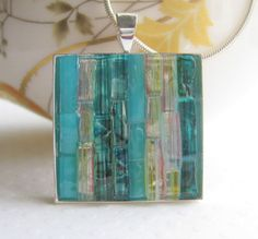Teeny tiny pieces of glass in a pendant.  Gorgeous!