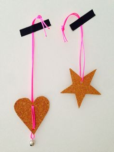 Home made Christmas decorations made from cork. With a twist of neon...