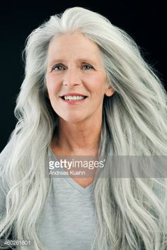 Photo : Mature woman with wind blown, long, gray hair.coi