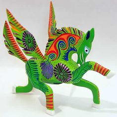 Mexican Folk Art - Green Pegasus Alebrije  Feel the strength of this whimsical creature through its bold design and taking flight stance.  Fair Trade and hand crafted in Oaxaca, Mexico of the indigenous Copal wood.  $25.99