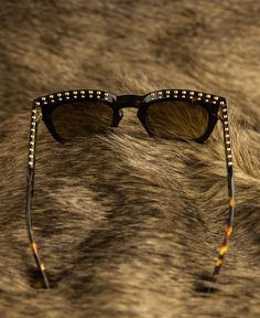 Statement style in studded Givenchy shades and fur.