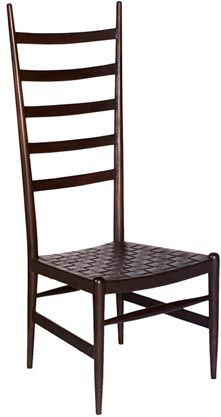 This chair, also from Oly, might make a good secondary chair in the room. The uprights make me think of gazelle horns. (But chairs with horizontal splats always look uncomfortable to me. Slouching not allowed. Maybe that's a good thing. The uprights make a nice visual frame for the (narrower) sitter, though.)