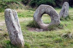 """The Mên-an-Tol (also Men an Toll) is a small formation of standing stones in Cornwall, United Kingdom. It is about three miles northwest of Madron. It is also known locally as the """"Crick Stone"""". Granite Stone, Stone Slab, Madonna, Elemental Magic, Celtic Nations, Stonehenge, Bronze Age, Great Britain, Garden Sculpture"""