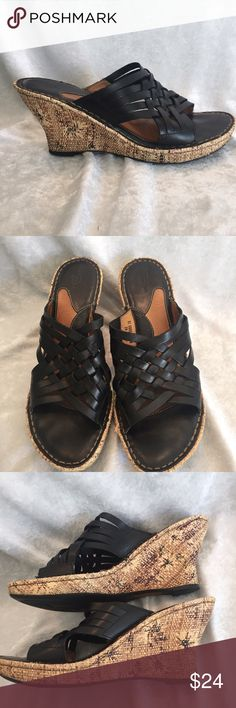 BORN black leather strappy wedges These shoes are basically in new condition. Worn once. They are open toe BORN leather shoes that strappy weave top. Flower design wedge. Size is 10. 🍀 I offer personalized bundle discounts 🍀 Born Shoes Sandals