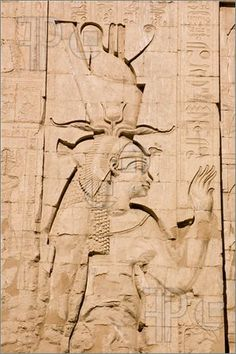 Large stone carving of the ancient egyptian goddess Ma'at, Temple of Horus, Edfu, Egypt. Ma'at is the goddess of truth, justice and harmony and has feathers in her hair.