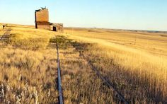 Okaton , South Dakota , Cattle and crops built this prairie ghost town in the early 1900's , Oakton was once a bustling town on the railroad to Rapid City . Folk's left when the railroad abandoned Oakton and I-90 bypassed it . All thats left of this prairie ghost town are a few ruins including the old grain elevator .