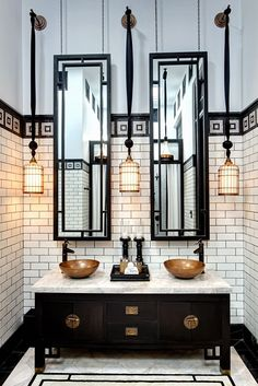 copper accents / tall hanging mirros / subway tile / tile pattern / hanging cage lights
