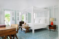 Love the floor mixed with wood & fresh white furnishings...very beach housey!