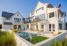 Beach House ~ivory siding with the charcoal gray shutters/windows and metal roof.