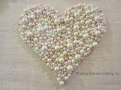 DIY Burlap and Pearls Heart Tutorial...she shows how to make the heart and frame it up beautifully. I love the vintage look it has!