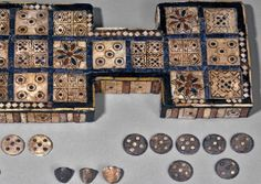 The Royal Game of Ur gets its name from two boardgames which were found in tombs by Sir Leonard Wooley, who was carrying out excavations in the ancient city of Ur in the 1920s.    Read more at: http://www.gamecabinet.com/history/Ur.html    Image from www.britishmuseum.org
