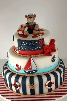 A children's birthday cake designed as a boating theme, sailboats, anchors, red and blue topped with a sailing teddy bear. Sweet Cakes, Cute Cakes, Beautiful Cakes, Amazing Cakes, Sailor Cake, Comida Para Baby Shower, Nautical Cake, Nautical Theme, Seaside Theme