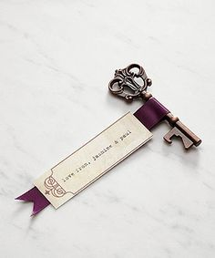 Cute wedding favor - skeleton key bottle opener! Could also use to attach escort cards #vintagewedding