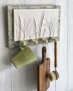 """Plaster mural """"Herbs of provence"""" as mudroom entryway key holder. Square botanical bas-relief on wood panel hanger with 4 hooks for kitchen Wooden Wall Decor, Wooden Hangers, Ceramic Decor, Wooden Walls, Ceramic Pottery, Ceramic Art, Slab Pottery, Thrown Pottery, Ceramic Bowls"""