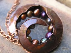 Fold formed seed pod necklace in copper with by jennyekberg,