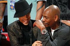 Prince sits courtside and talks with comedian Dave Chappelle at the 2007 NBA All-Star Game on Feb. 18, 2007 at Thomas & Mack Center in Las Vegas, Nev.  Andrew D. Bernstein/NBAE/Getty Images