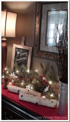 Lighted garland and birch logs
