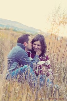 Inexpensive date idea: Go find a field, preferably one with tall grass, and sit and watch the sunset together. Don't forget to smooch a little... okay, a lot!