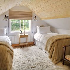 Stained or left bare, wood makes a low-ceilinged attic feel snug and cozy. | Photo: Bruce Hemming/IPC Images | thisoldhouse.com |