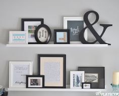 picture wall ideas A DIY Picture Ledge is a perfect option to display assorted art. Get the details on how you can make a DIY Picture Ledge for your space! Picture Ledge Bedroom, Ikea Picture Ledge, Picture Frame Display, Gallery Wall Bedroom, Picture Wall, Photo Ledge Display, Picture Frames On Shelves, Gallery Wall Shelves, Gallery Frames
